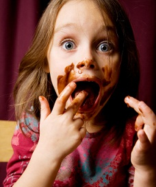 Girl eating contaminated chocolate